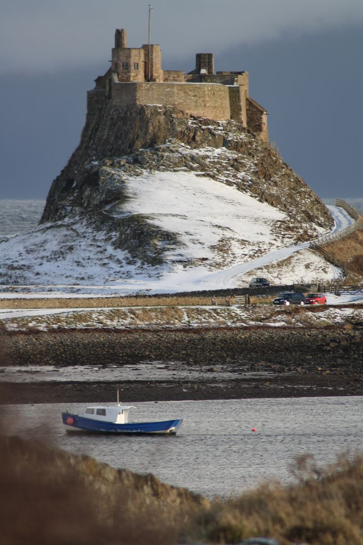 Lindesfarne Castle on Holy Island off the coast of Northumberland in England. St Aiden brought Christianity to England in 635AD. You can only drive over a Causeway when the tide is out.