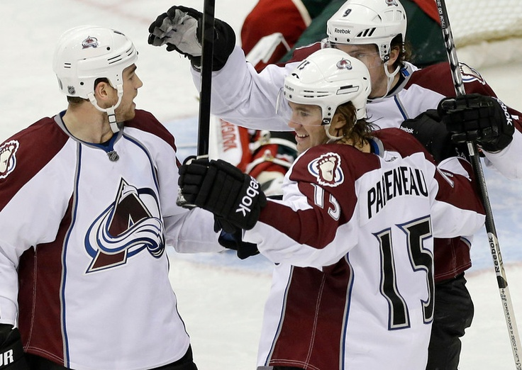 Colorado Avalanche's Ryan O'Reilly, left, joins in the celebration after P.A. Parenteau (15) scored his second goal of the night off Minnesota Wild goalie Niklas Backstrom, during the third period of a game on 3/14 in St. Paul, Minn. The Wild won 5-3. (Photo: Jim Mone, Associated Press)