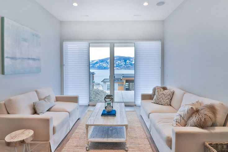Hunter Douglas silhouette window shadings in the family room, showing she panels closed, middle panel open.