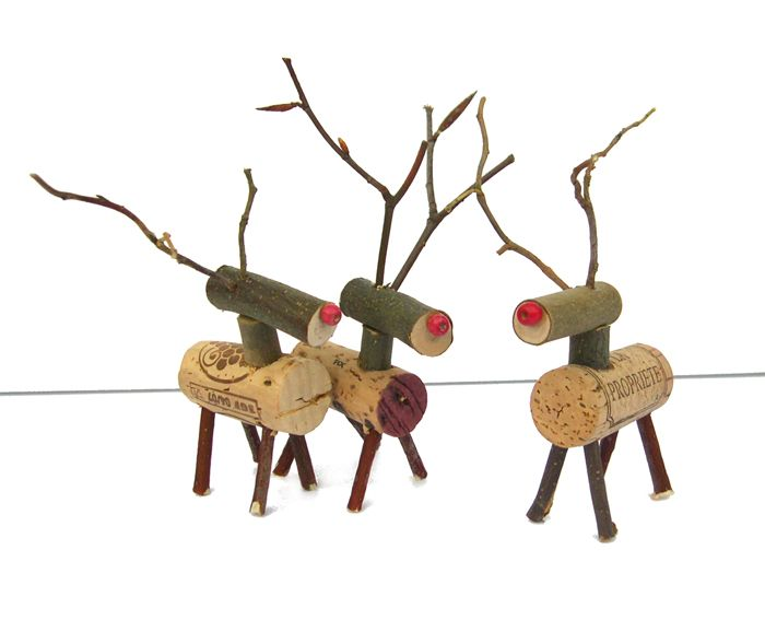 What a clever way to use corks and twigs and berries                                       to make these adorable reinde