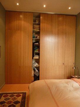 Closet doors Full-height bamboo doors http://www.plyboo.com Master closet - modern - bedroom - san francisco - At-Six Architecture