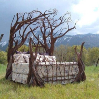 Bed frame made of tree branches. Bed frame made of tree branches.