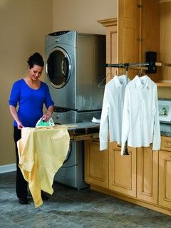 """Retracting drop down hanging rack along with the pull out ironing board. The rack can be adjusted all the way to 47"""" wide."""