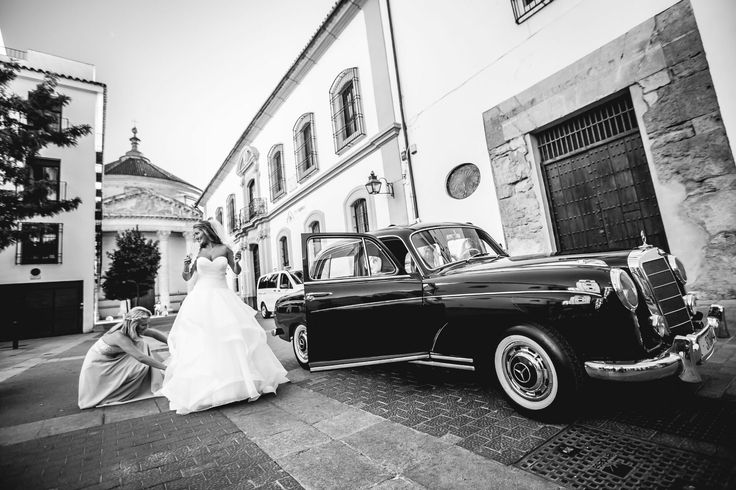 Brides in action! Stunning dress and stunning car for a stunning occasion...see more stylish ideas at www.myweddingnotebook.co.uk