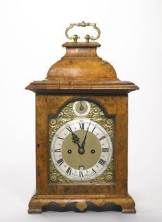A George II walnut table clock, circa 1740, case associated 6-inch dial signed on the chapter ring John Ellicott London with strike/silent dial in the shallow arch, the two train bell striking five-pillar fusee movement with verge escapement and leaf-scroll engraved backplate in an inverted bell-top case