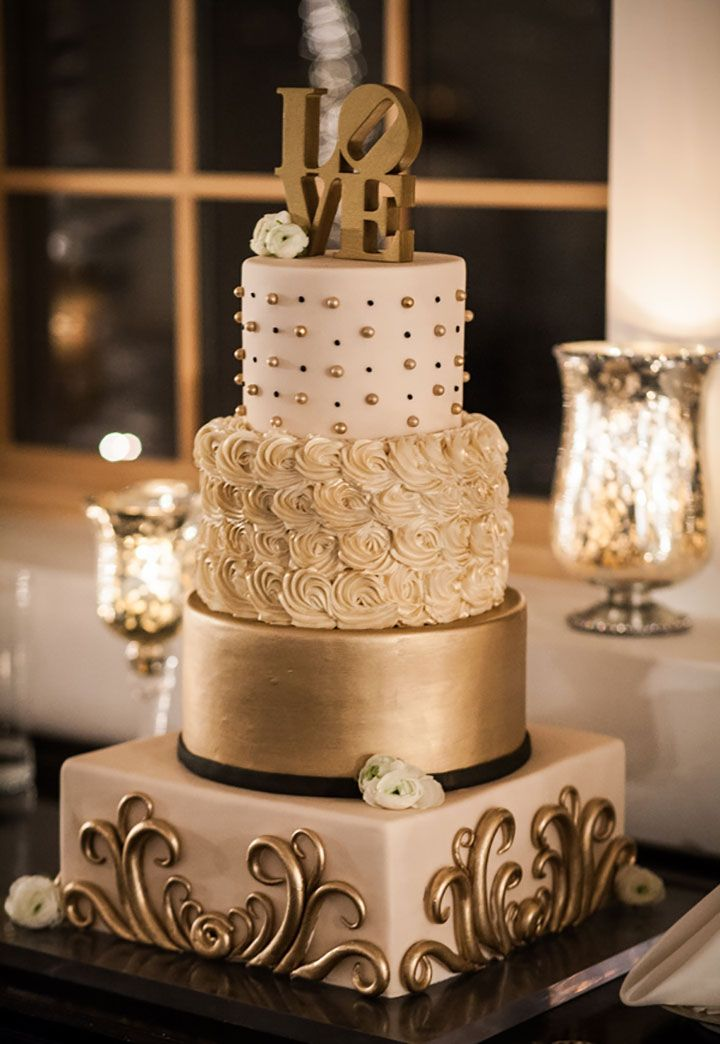 Beautiful 4 tiered textured gold wedding cake for New Year's Eve
