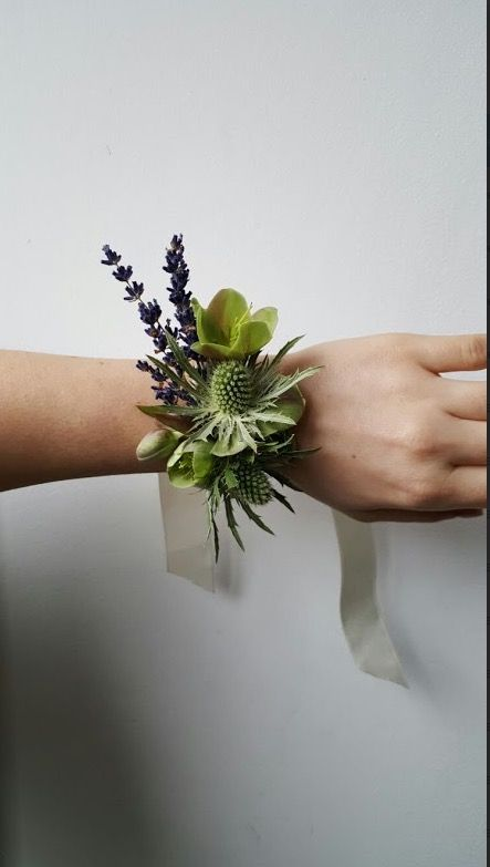 Hellebore, rosemary, lavender and thistle wrist corsage by Grace & Thorn.