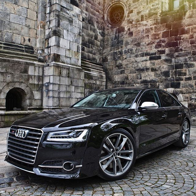 The stylish and aggressive S8 Plus, poses for me in a grayish environment.  Car…