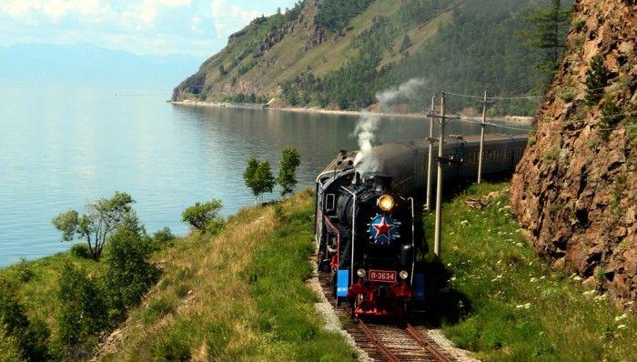 Golden Eagle's luxury train traveling beside Lake Baikal on the Trans-Siberian Express railway