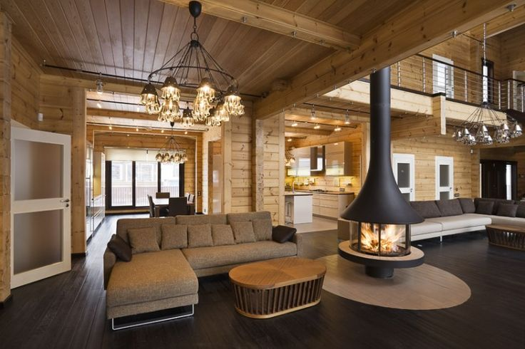 Log home living room. Looks super comfy.