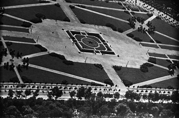"""Revolutionary necropolis, 1931. A memorial complex for victims of the revolution on the Field of Mars. Made from red granite by architect Rudnev. From a series of photos of Leningrad from the air, taken for the magazine """"USSR in Construction"""". Russia"""