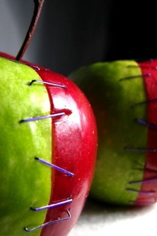 Macabre Apples. I'll remember this for Halloween. Maybe dental floss sewn in would be a safer resort