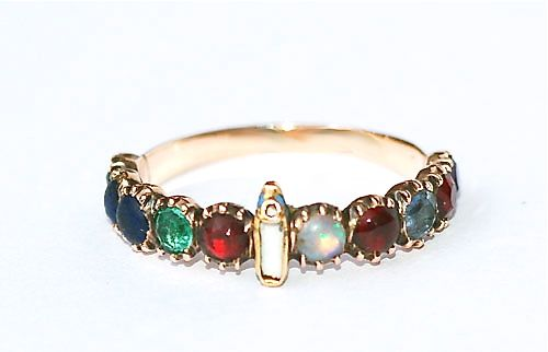 """Slipper Ring that uses the first letter of each gemstone to spell out a sentimental or loving word or phrase (i.e. """"dearest"""" or """"regard"""").- Elle vous va"""" — """"it suits you"""" or, keeping the tiny slipper in mind, """"it fits you."""""""
