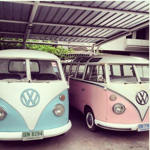 His (pale blue) & Hers (pastel pink) VW Camper vans