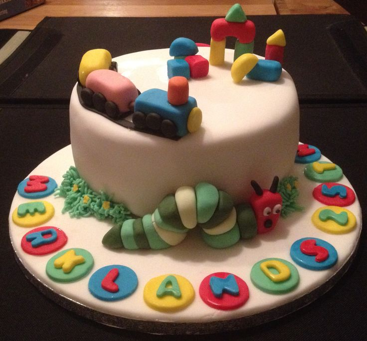 Nursery cake. Vanilla sponge with jam and vanilla buttercream with fondant decorations and a fondant hungry caterpillar.