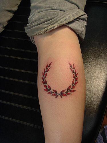 Capricorn-Laurel tattoo.