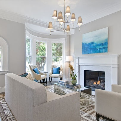 I love traditional rugs w/contemporary furniture. Mirrored cocktail table is awesome in the room. Paint: Benjamin Moore Balboa Mist.