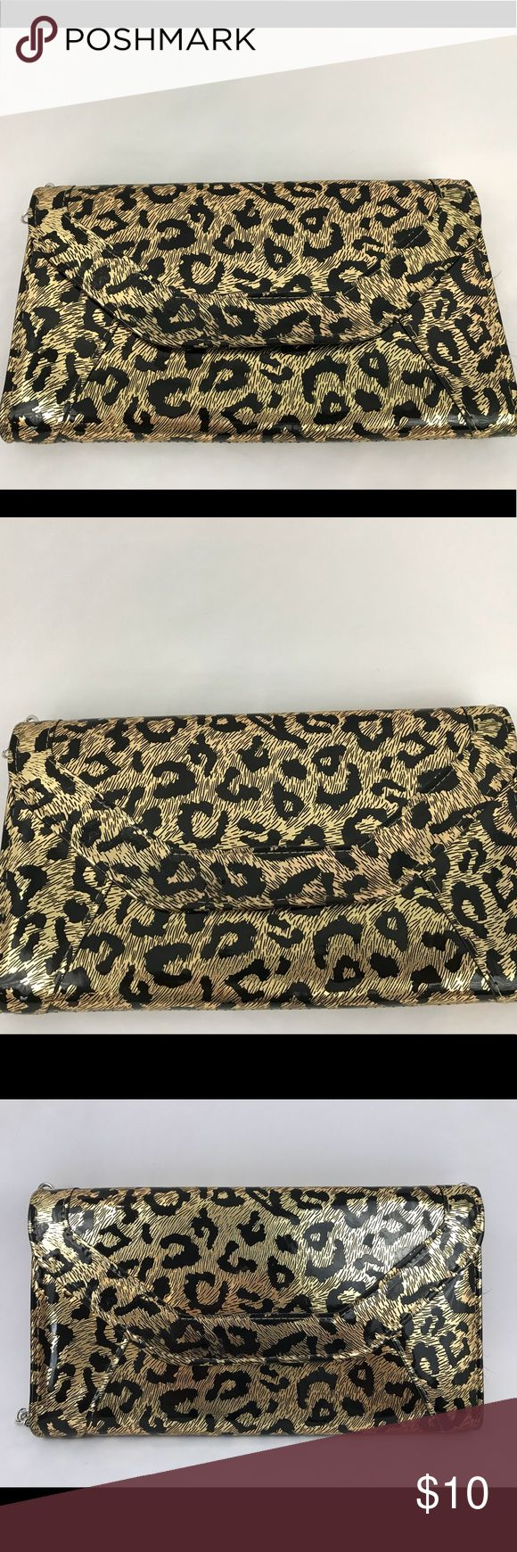 Metallic leopard print clutch with removable strap Adorable clutch with a metallic and leopard print. Comes with a removable chain strap so it can be a shoulder purse as well as a clutch. Bags Clutches & Wristlets