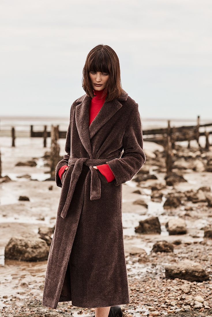 Try delicate dark brown coat instead of classic black. We just love Autumn jacket by Manuela Conti.