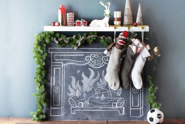 We found three festive ways you can create a faux mantel this holiday season that even Kris Kringle would love.: A Chalkboard Fireplace