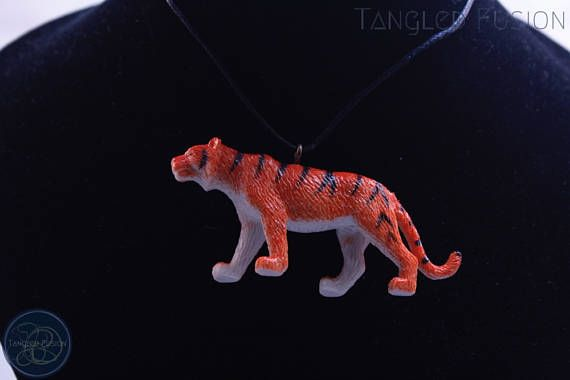 Quirky Handmade Adjustable Animal Necklace on Leather  Design: Tiger      Tangled Fusion offers a wide scope of quirky, fun jewellery and handmade creations.   https://www.etsy.com/au/listing/538076153/quirky-handmade-adjustable-animal?ref=shop_home_active_1