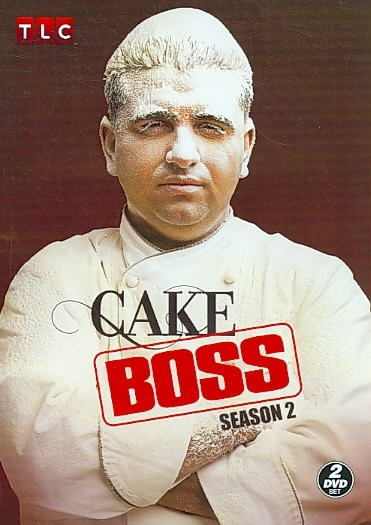 Cake Boss Season 2 [TX771.2 .C354 2010] Master baker Buddy Valastro, owner of Carlo's City Hall Bake Shop in Hoboken, NJ, is one of the most successful and renowned cake artists in the country. Follow Buddy as he supervises a team that includes his mother, four older sisters, and three brothers-in-law in an effort to achieve his late father's dream of making the family-owned business a household name.