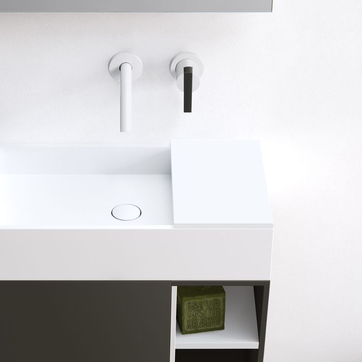 Edge hand rinse, simple yet sophisticated and characterised by its minimalist rectangular appearance and thin 12mm edge. A completely (hand) made to measure basin out of HI-MACS (solid surface). This basic-shaped basin is ideal for design purposes and easily adaptable. Featured: Edge hand rinse basin in Alpine white HI-MACS on top of a Fenix NTM wall mounted cabinet. Create a small countertop with our HI-MACS Cover. bathsbyclay.com