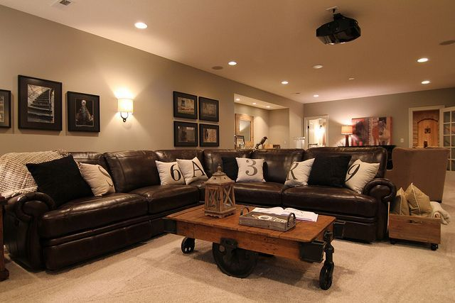 LOVE this! Every cave must have a brown leather couch with lots of room to watch the game. Even for the first floor.