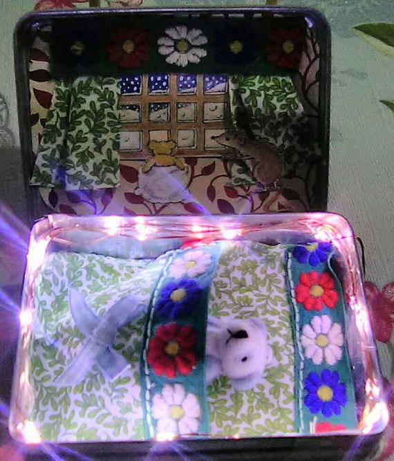 This is a little pocket night light in a tin. The bed is hand stitched and the rest is all handmade. These are so popular that ive sold 93 of them so far at events and through my facebook page Teeny Tiny Pocket World. Fits into a pocket or handbag. Lovely cute teddy inside.