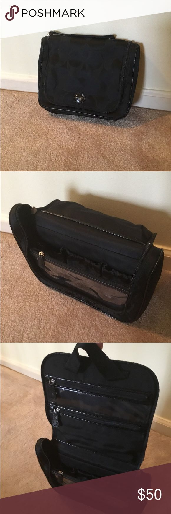 Signature Nylon Travel Cosemtic Black cosmetic toiletry bag - has a loop to hang on hook or door, multiple storage pockets, great for travel.  This goes great with the 2 nylon bags that are listed 😁 Coach Bags Travel Bags