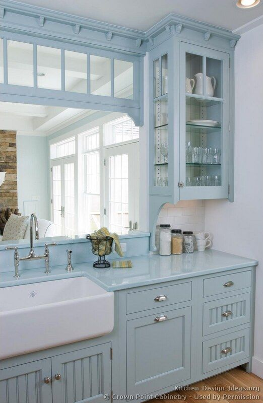Love the blue painted cottage kitchen cabinets!
