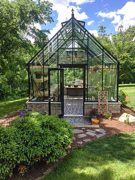Summer! The Cape Cod Greenhouse. And nice rock wall and flooring. garden-greenhouse.se