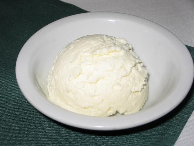 Kajmak or kaymak is a Serbian/Croatian/Macedonian unripened (not aged) cheese similar to clotted cream still made in many kitchens today. It is usually served with bread as an appetizer.