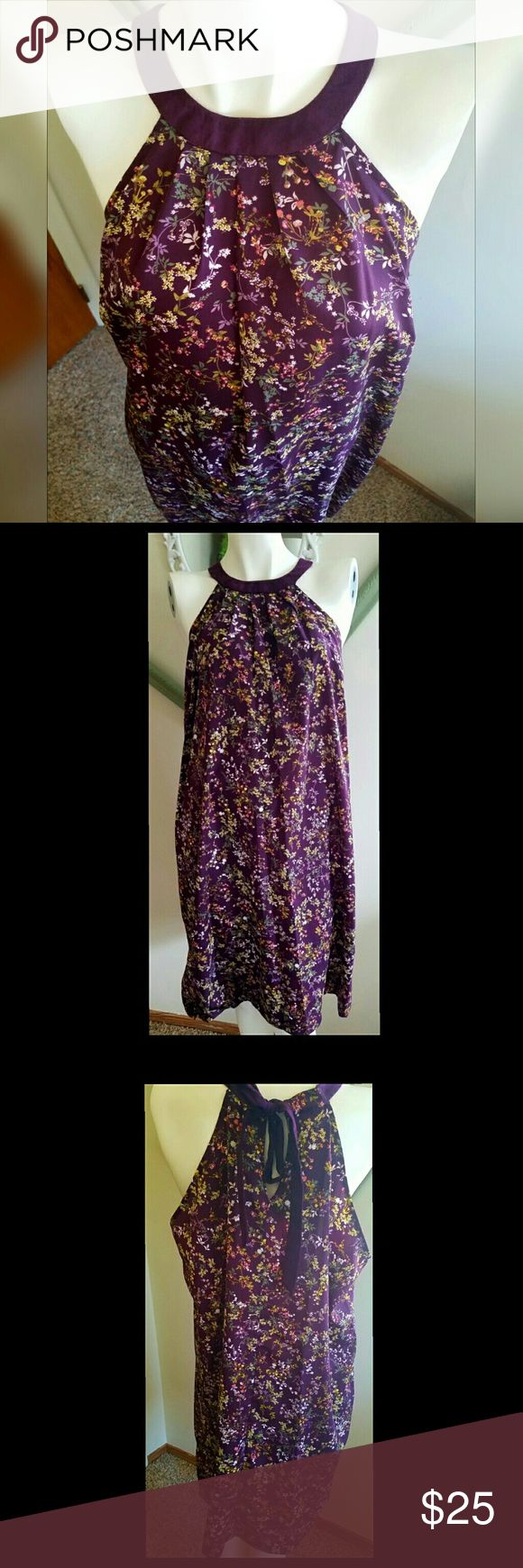 "NWOT. Gorgeous Purple Floral Dress NWOT. Purple with sage, green, lavender and coral. Suede tie around collar. Has pockets. Keyhole in back. 100% polyester and neck tie is faux suede. Machine washable.   Measurements  Bust 44"" Waist 39""  Hip 46.5""  Length (from collar down) 36""   Get an additional 30% off when purchasing 3 or more items using the bundle feature. Always willing to negotiate. Make an offer. Merona Dresses"