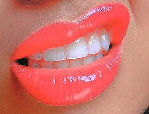 Lipgloss- i seriously love everything about this picture. The colour, her teeth, i dont know. I just, really like it.