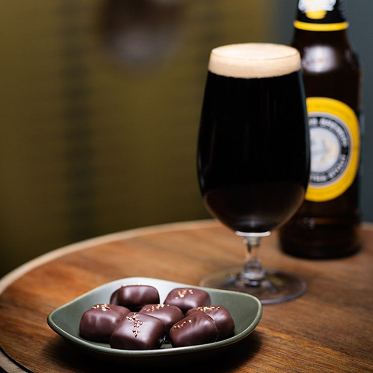 Coopers Stout Ganache - a rich, dark chocolate ganache centre is flavoured with Coopers' award winning Stout. A top layer of smooth malt frappe completes the centre which is enrobed in premium dark chocolate and decorated with bronze pearls.