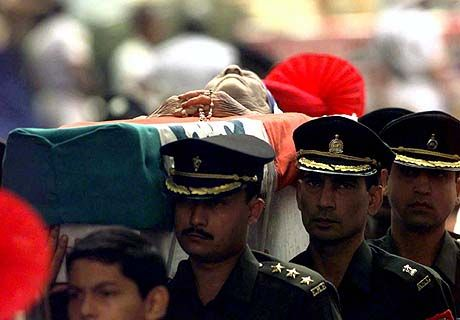 Funeral for Mother Teresa, September 13th 1997. Indian military pall-bearers carry the body of Mother Teresa from St. Thomas's Church to the gun-carriage at the beginning of the funeral procession. Photo credit: AP