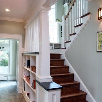 Adore the staircase (bookshelf/boxes beneath it) and the little nook on the landing.