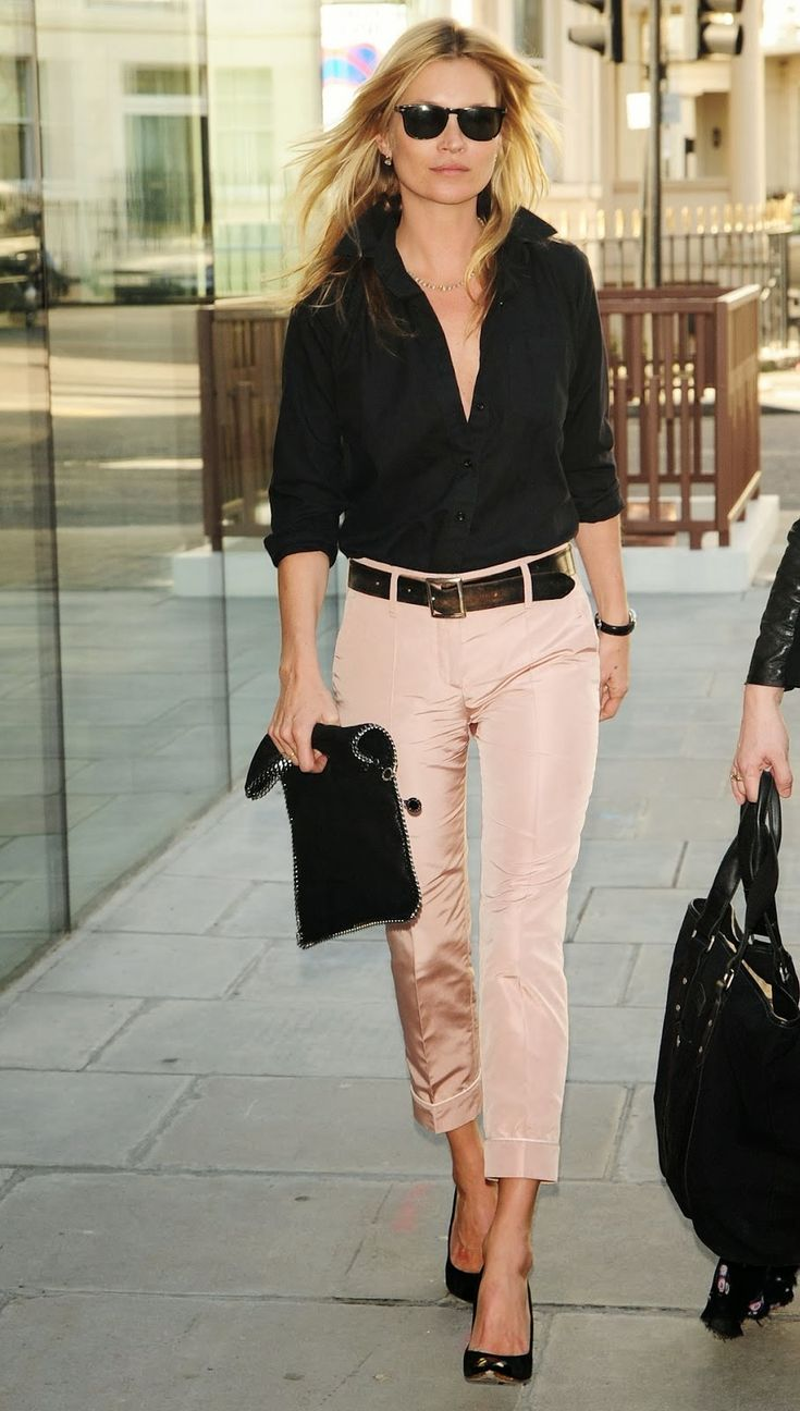Ms Moss, perfectly styled in shell pink pants and black shirt