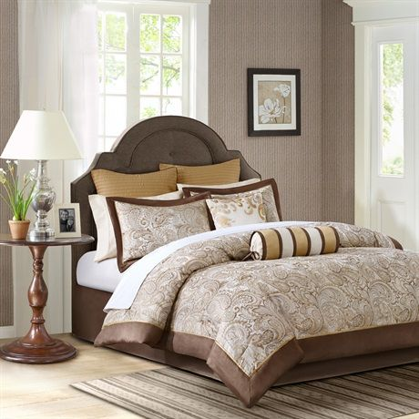 """If classic is your style, Aubrey is perfect for you. The jacquard weave is inspired from an updated paisley motif and is woven into a beautiful combination of chocolate brown, gold and a hint of ivory for a touch of sheen to your bedding. The comforter and shams offer beautiful details with a 2"""" flange and 1/2"""" flat piping in a chocolate brown. The reverse of the comforter is a rich gold color. The sheets are 100% cotton, 200 thread count, and the light ivory coordinates back perfectly to…"""