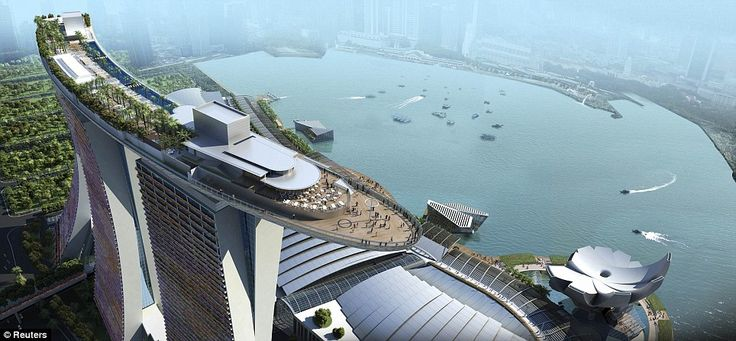 The Marina Sands hotel in Singapore. This is amazing .. it looks like an ocean liner sitting on top of three buildings.