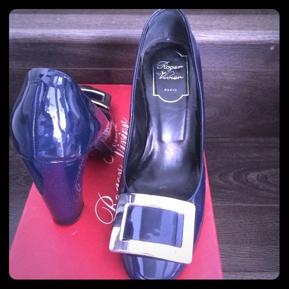 Roger Vivier classic buckle pumps in navy Roger Vivier's classic buckle pumps in navy blue patent leather. Looks great with everything!  Worn but in clean condition. Roger Vivier Shoes Heels