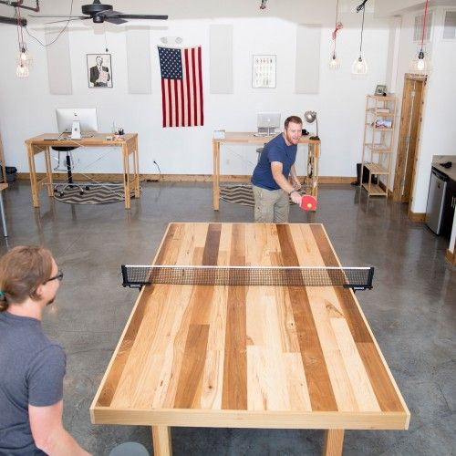 Ping pong table made from reclaimed hardwood floors. DIY, custom made.