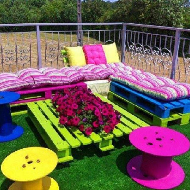 Cable reels, and pallets! So easy!! A little bright, unless you used it in a corner of the yard or deck--for the kiddos.