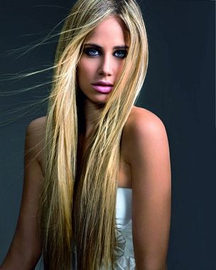 A long blonde straight coloured hairstyle by Royston Blythe
