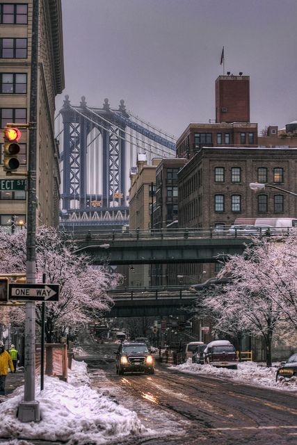 NYC. Manhattan. Dark steel  and brown stone, colourful blossoms and white snow. Nice palette.