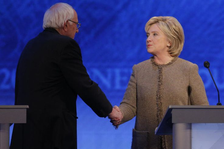 Democratic presidential candidate Senator Bernie Sanders shakes hands with rival Hillary Clinton at the conclusion of the Democratic presidential candidates debate at St. Anselm College in Manchester, N.H., Dec. 19, 2015. (Photo by Brian Snyder/Reuters)