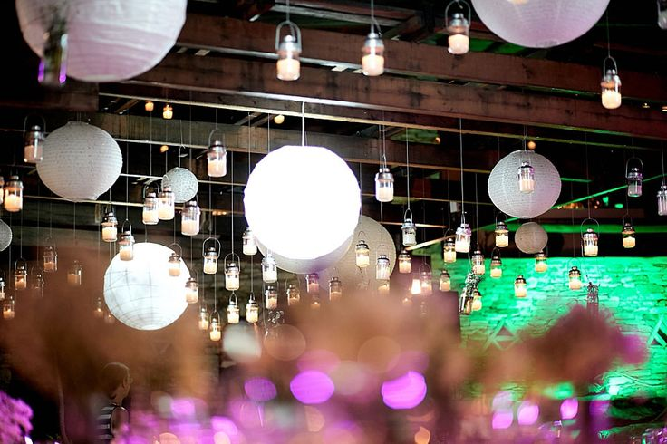 Light up the party with hanging lanterns on the pergolas!