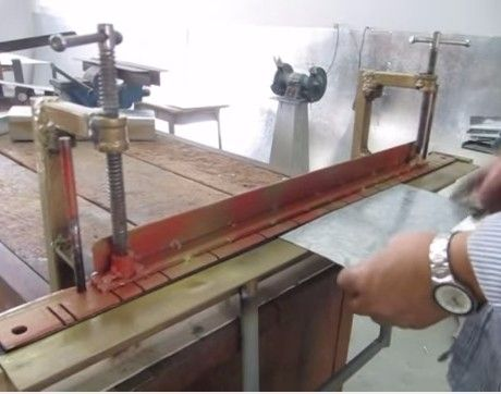 Sheetmetal Brake by Mohamed Hisham -- Homemade sheetmetal brake constructed from angle iron, surplus clamps, tubing, pipe, and steel rod. http://www.homemadetools.net/homemade-sheetmetal-brake-32