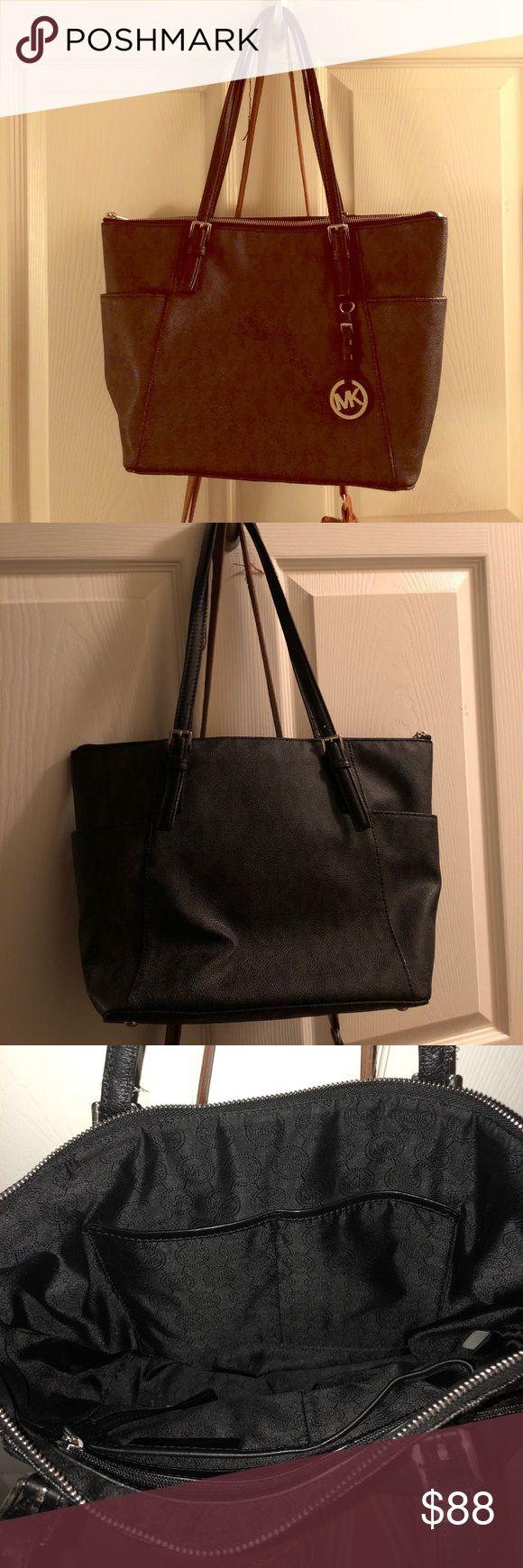 Black Michale Kors jet set bag Lightly used Michael Kors jet set medium purse with mk pattern lightly used KORS Michael Kors Bags Totes